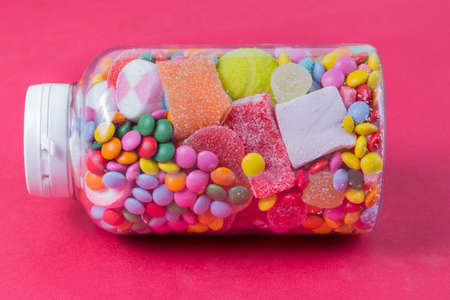 Glass jar full of candies Stock Photo