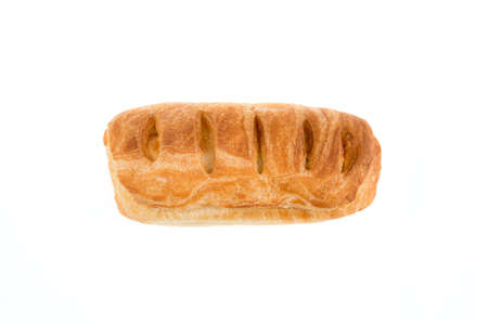 Baked puff pastry with a filling on a white background. view from above