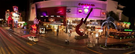 Cancun, Mexico - December 15, 2011: Night panoramic of the entertainment district at Forum in Cancun Mexico. This area is near the convention center and has night clubs, restaurants and shopping which includes: Coco Bongo Show & Disco, Hard Rock Cafe, Éditoriale