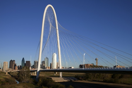 The new  Margaret Hunt Hill Bridge that crosses the Trinity River in Dallas, Texas. The bridge uses a unique  design of a  400-foot steel arch and cables to support  the bridge. The bridge is still under construction and will open in 2012.  Stock Photo