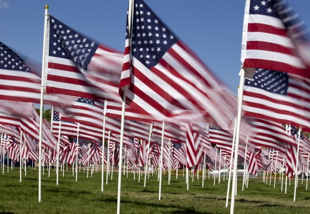 Patriotic flag display with a long exposure for blur effect on flag motion