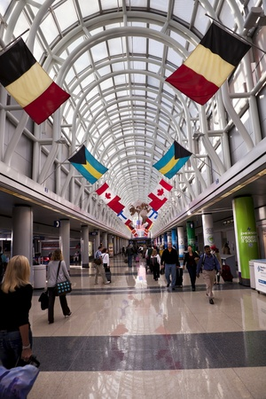 Chicago, Illinois, United States - September 7, 2011: Travelers at Chicago O'Hare International Airport which is the primary airport serving the Chicago area. O'Hare is the third busiest airport in the world with over 66.6 million passengers  Stock Photo - 12058633