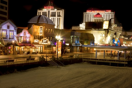 Atlantic City, New Jersey, USA - September 1, 2011: View of the Atlantic City Boardwalk and Casinos from the beach at night. 에디토리얼