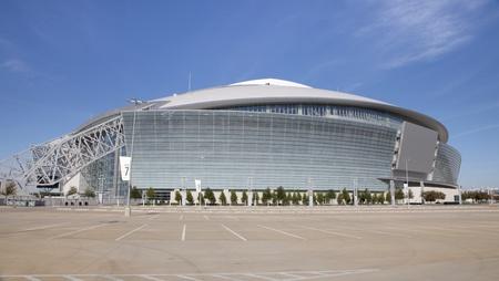 serves: Arlington, Texas, USA - November 29, 2011: Cowboy Stadium is a domed stadium with a retractable roof in Arlington, Texas. It serves as the home of the National Football League Editorial