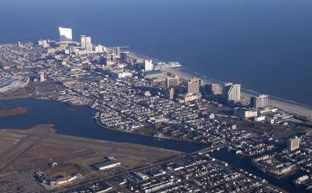 Atlantic City, New Jersey, USA - January 25, 2012: Aerial View of Atlantic City New Jersey showing the casino strip along the world famous boardwalk., the closed Bader Field, also known as Atlantic City Municipal Airport and Bernie Robbins Stadium,