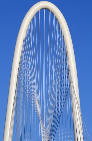 Architectural detail of the top of the  new  Margaret Hunt Hill Bridge that crosses the Trinity River in Dallas, Texas. The bridge uses a unique  design of a  400-foot steel arch and cables to support  the bridge.