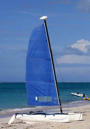 Sailboat on a tropical island beach in the caribbean Stock Photo - 12193758