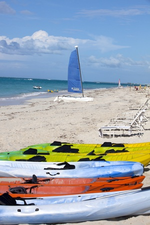 Kayaks and sailboat on a tropical island beach in the caribbean Stock Photo - 12193762