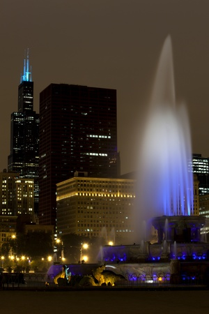 Chicago Famous Fountain and the Skyline on an overcast night photo