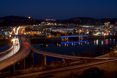 Charleston - West Virginia and  n the Kanawha River at night  Moon is rising on the mountain