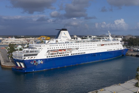 Freeport, Bahamas - February 27, 2012: Bahamas Celebration cruise ship opperated by Celebration Cruise Line coming into Freeport, Bahamas on morning Feb. 27, 2012. Taken two days before a woman disappeared from the ship on return voyage to Maimi Stock Photo - 12513562