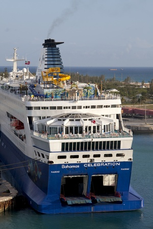 Freeport, Bahamas - February 27, 2012: Bahamas Celebration cruise ship opperated by Celebration Cruise Line coming into Freeport, Bahamas on morning Feb. 27, 2012. Taken two days before a woman disappeared from the ship on return voyage to Maimi Stock Photo - 12513563