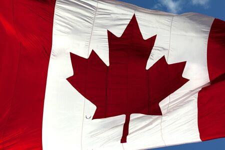 Closeup of a large Canadian Flag blowing in the wind  photo
