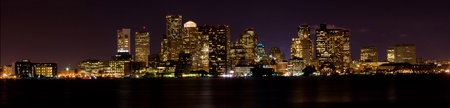 refelction: Panoramic view of downtown Boston skyline at night refelction in the water   5 pictures were used to make this panoramic image  Stock Photo