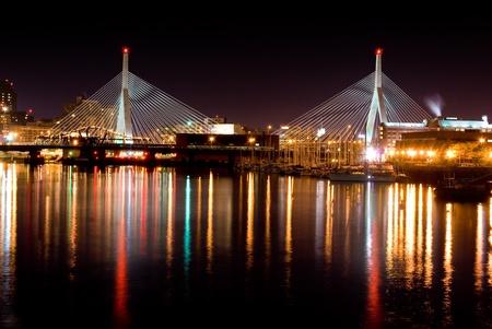 boston cityscape: Leonard Zakim bridge in Boston Fishing pier in the foreground on Right side of picture  Stock Photo