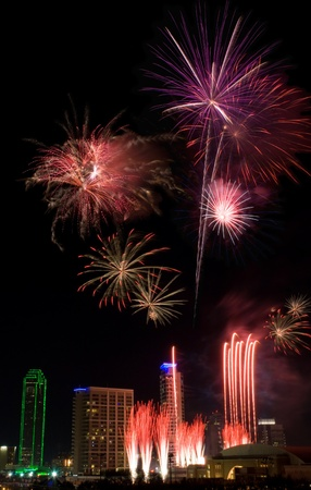 Colorful fireworks display in Dallas, Texas celebrating New Years Eve  Business district and office buildings  photo
