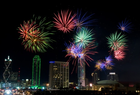 Colorful fireworks display in Dallas, Texas celebrating New Years Eve  Business district and office buildings