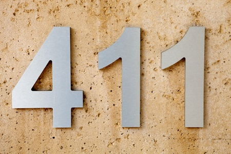 especially:  411  is the slang term for Information or knowledge, especially when acquired by word of mouth Stock Photo