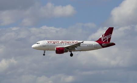 Fort Lauradale, Florida, USA - April 22, 2012  A Virgin American passenger jet airliner coming in for a landing at Fort Lauradale international airport