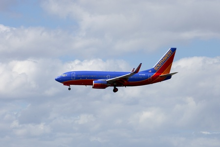 A Southwest passenger jet airliner coming in for a landing at Fort Lauradale international airport