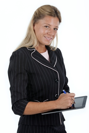 blank tablet: Woman  teacher or businesswoman , using a stylist on a blank electronic tablet  Shot on a white background  Stock Photo