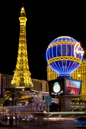 las vegas city: Nightlife along the Las Vegas Strip in front of the Paris Casino  Picture shows th Paris balloon and the Eiffel Tower replica which is about half the size of the original in France  Long Exposure  Editorial