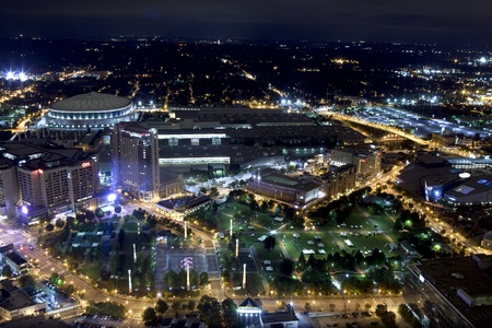 overlooking:  Aerial view of Atlanta Georgia overlooking Centennial Olympic Park area at night  Picture shows the Georga Dome, CNN Center, Omni Hotel, Georgia World Congress Center, Georga Aquarium, World of Coca Cola, Centennial Olympic Park and headquarters of the A
