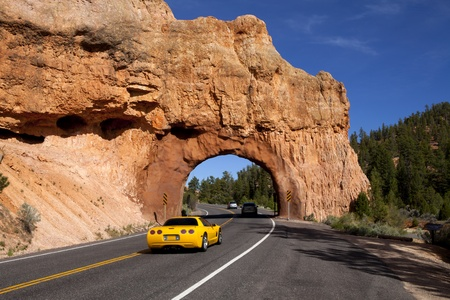 Rock arch with roadway passing through it , Unique rock formation caused by erosion at Red Canyon in Utah  Near Bryce Canyon