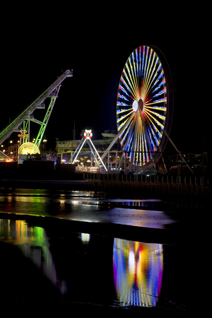 wildwood: Amusemant Pier in Wildwood, New Jersey with lights reflecting in water Stock Photo