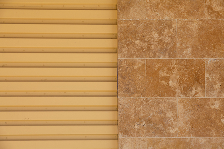 cladding tile: Contrast in patterns between tile and metal siding  Background - texture and pattern  Stock Photo