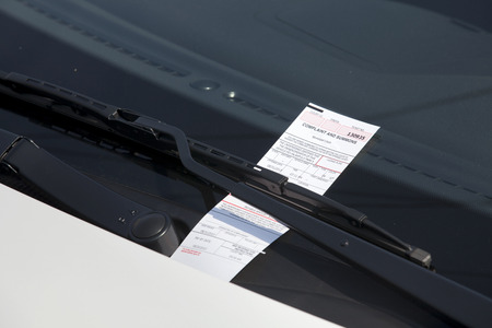 Electronic parking ticket on windshield of car