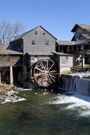 Watermill on the Little Pigeon river, in the mountain community of Pigeon Forge, Tennessee during the winter  Ice can be seen along the banks of the river photo