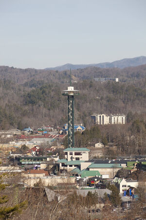 An aerial view of Gatlinburg Tennessee, USA, nesled in the valley of the Smoky Mountains   photo