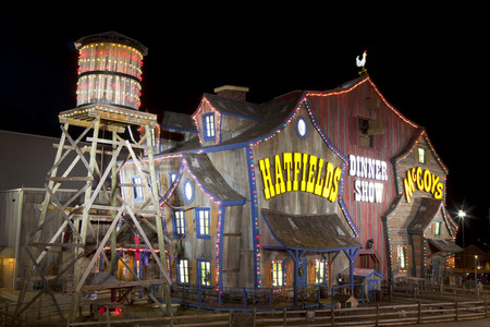 forge: The unique facade of the Hatfield   McCoy Dinner Show Theater make it a landmark and major tourist attraction in Pigeon Forge, Tennessee  The facade of the building resembles a large old farm barn with water tower
