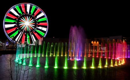 forge: Ferris Wheel in Pigeon Forge, Tennessee during the Christmas Holidays taken at night with long exposure with colorful water fountain in foreground Stock Photo