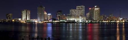 Panoramic Downtown New Orleans, Louisiana from the Mississippi River at night  photo
