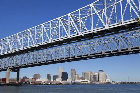 levy: Crescent City Connection  twin cantilever style bridges  which is U S  Route 90 going over levee  levy  and the Mississippi River in New Orleans, Louisiana, United States