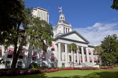 The old Florida State Capitol building as seen from Monroe St and Apalachee Parkway with the New Capitol in the background