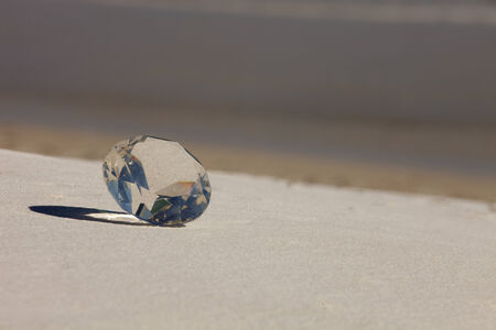 Glass Diamond on the beach with ocean in background Stock Photo - 25917345