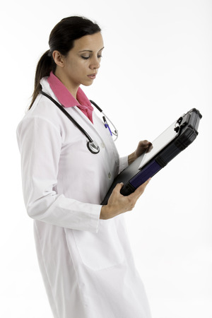 Female doctor with stephascope using a computer tablet photo