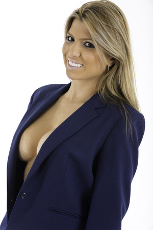 Sexy woman in an unbutton business suit jacket , looking at camera  Partly nude, shot on white background photo