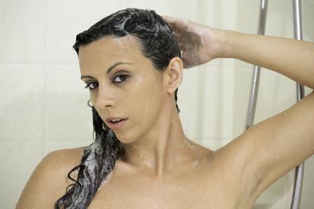 human's arm: Pretty woman taking a shower  Stock Photo