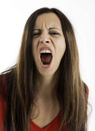 Angry woman look looking at camera and yelling, Shot on a white background