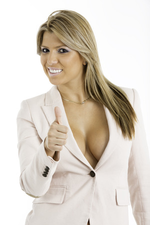 Sexy woman in an unbutton business suit jacket , looking at camera  Giving the thumbs up photo