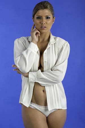 unbutton: Sexy woman wearing a unbutton white shirt and panties, partly nude
