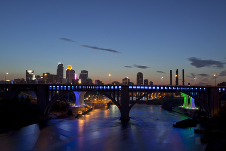Overlooking the Mississippi river with Central Ave bridge , I-35  blue bridge behind it   and downtown Minneapolis, Minnesota in the background