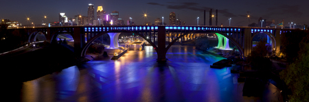 Panoramic overlooking the Mississippi river with Central Ave bridge , I-35  blue bridge behind it   and downtown Minneapolis, Minnesota in the background
