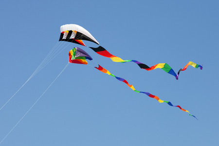 wildwood: Variety of colorful Kites in a clear blue sky at the Wildwood Kite Festival in New Jersey Stock Photo