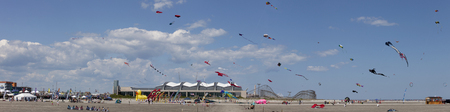 spring festival: Variety of colorful Kites in a clear blue sky at the Wildwood Kite Festival in New Jersey  Wildwood COnvention Center and amusemant Piers