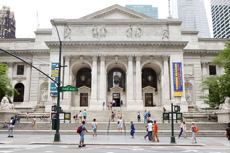 People going ro the New York Public Library located adjacent to Bryant Park at 5th Ave and 42nd Street in midtown Manhattan New York City, NY